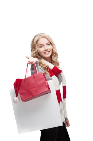 young happy smiling casual  blond woman holding  shopping bags isolated on white Stock Photo - 15971538