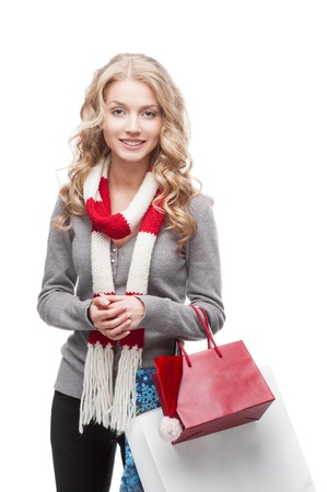 young happy smiling casual  blond woman holding  shopping bags isolated on white Stock Photo - 15971550