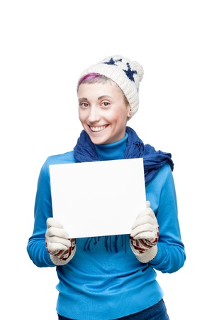 young smiling blond caucasian girl in winter clothing holding sign isolated on white photo