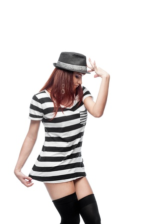 causasian: young stylish casual causasian brunette woman in hat and black and white short dress  isolated on white