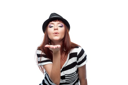 young stylish casual causasian brunette woman in hat and black and white stripe dress give a kiss  isolated on white Stock Photo - 16193694