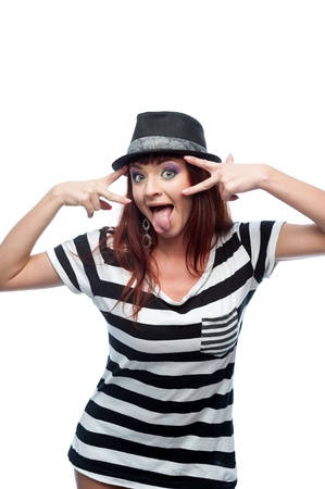 young stylish casual causasian brunette woman in hat and black and white short dress looking at camera with funny expression Stock Photo - 16193696