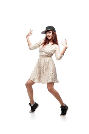 young caucasian red-haired female dancer showing move over white background Stock Photo - 16242003