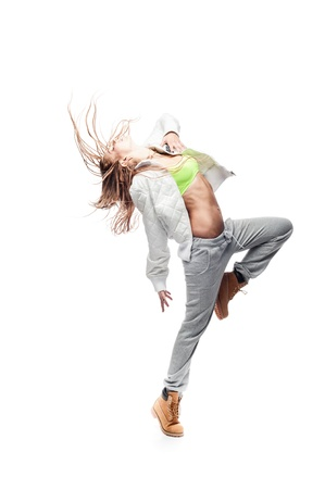 young caucasian hip-hop dancer woman showing some moves photo