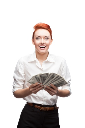 young red-haired caucasian smiling business woman holding a lot of money isolated on white photo