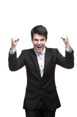 young smiling caucasian brunette businessman raised his hands with energetic successful expression Stock Photo - 16304571