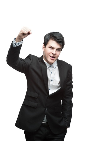 young caucasian brunette businessman raised his hand with energetic successful expression Stock Photo - 16304570