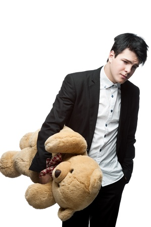 young caucasian brunette businessman holding big soft toy bear with sad expression Stock Photo - 16304500