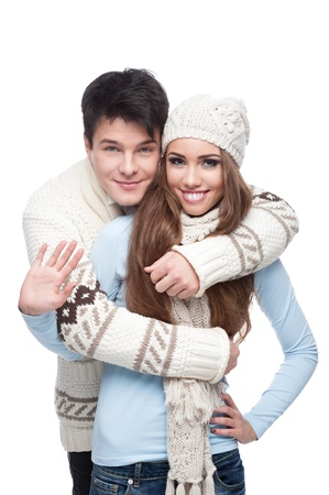 young smiling caucasian brunette couple in winter clothing embracing photo