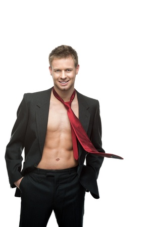 portrait of young caucasian sexy smiling man in black suit and red tie dressed over naked body