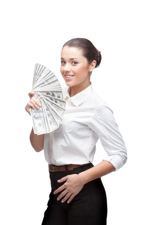 giovane allegro imprenditrice indoeuropea bruna in bianco denaro camicia holding isolato su bianco Archivio Fotografico