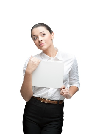 young thoughtful caucasian brunette businesswoman in white blouse holding sign isolated on white photo