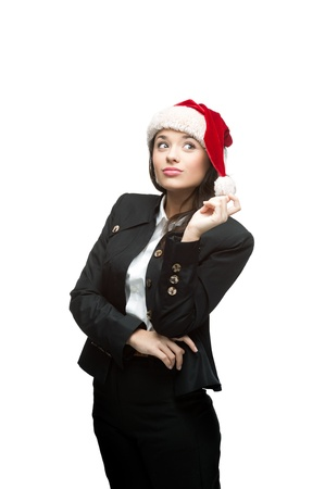 young thoughtful caucasian brunette businesswoman in black suit and santa hat  isolated on white photo