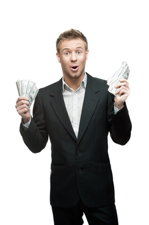 business costume: young funny screaming caucasian businessman in black suit holding money isoalted on white