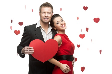 young smiling caucasian couple holding sign in form of red heart isolated on white background photo