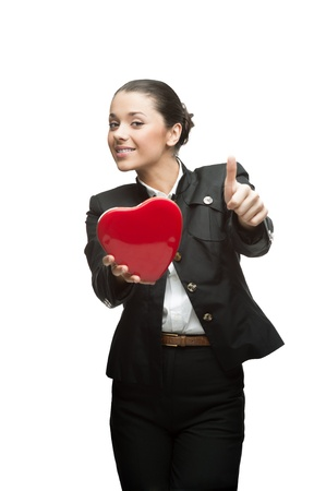 smiling young caucasian business woman in black suit holding red heart isoalted on white photo