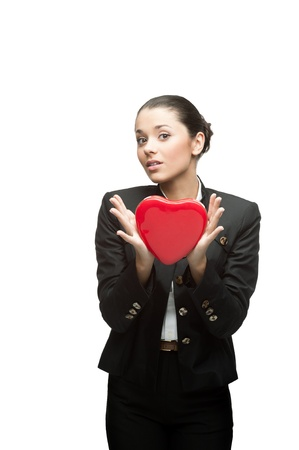 young caucasian business woman in black suit holding red heart isoalted on white photo
