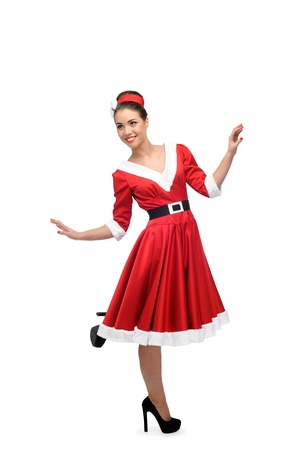 cheerful young caucasian woman in red vintage clothing dancing isolated on white Stock Photo - 16937352