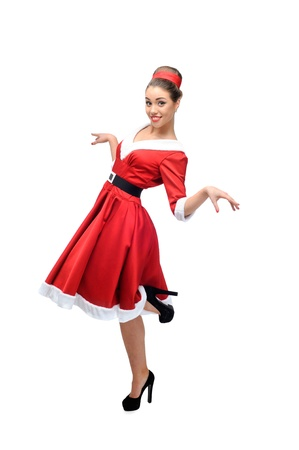 cheerful young caucasian woman in red vintage clothing dancing isolated on white Stock Photo - 16937351