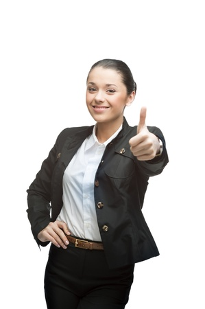 young smiling caucasian businesswoman in black suit showing thumb up isolated on white background photo