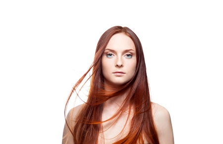 portrait of young caucasian red haired girl with windy hair isolated on white photo