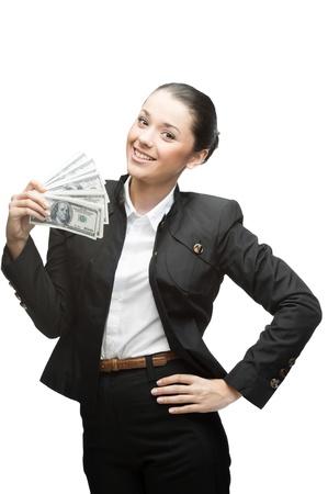 giovane imprenditrice felice caucasica in denaro nero nell'azienda tuta isolato su sfondo bianco