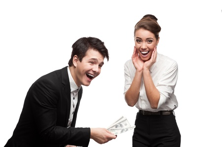 young brunette caucasian businessman giving a lot of dollars to surprised smiling business woman photo