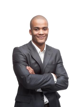 giovane allegro nero uomo d'affari in piedi isolato su bianco Archivio Fotografico