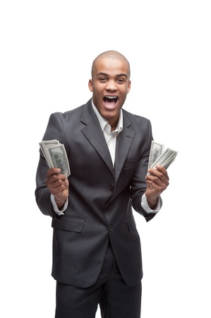 man holding money: young screaming black businessman holding money isolated on white
