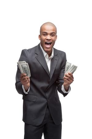 black money: young screaming black businessman holding money isolated on white