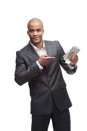 young cheerful black businessman holding and pointing at money isolated on white Reklamní fotografie
