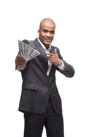 young cheerful black businessman holding and pointing at money isolated on white photo