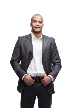 black man: young cheerful black businessman standing isolated on white Stock Photo