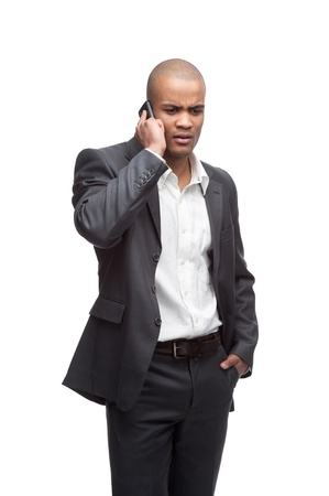 young woried black businessman talking on cell phone isolated on white photo