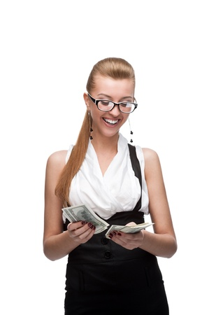 young cheerful caucasian businesswoman counting money isolated on white photo