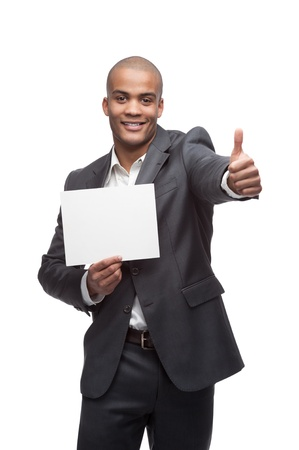 holding a sign: young cheerful black businessman holding sign and showing thumbs up isolated on white