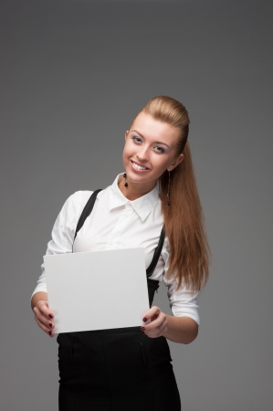 young cheerful caucasian businesswoman holding sign isolated on white Stock Photo - 17891127
