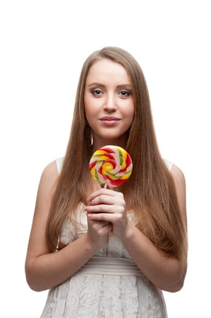 cute caucasian girl holding big round lollipop isolated on white photo