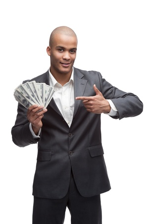 black young smirking businessman in gray suite holding and pointing at money isolated on white photo