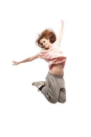 beautiful young casual caucasian  hip-hop dancing woman  over gray background photo