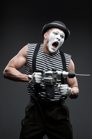 finny agressive mime holding puncher Stock Photo - 20580171