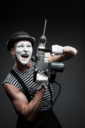 agressive: finny agressive mime holding puncher