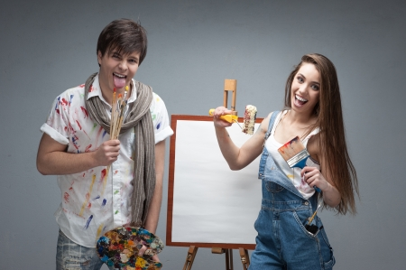 crazy woman: man and woman painters emotionally discussing art project