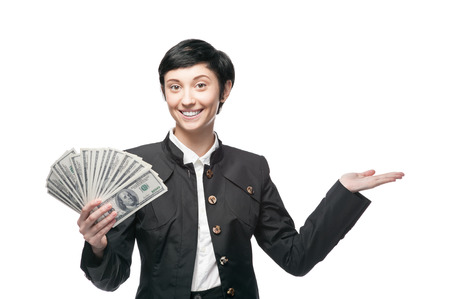 caucasian businesswoman in black suit holding money. isolated on white photo