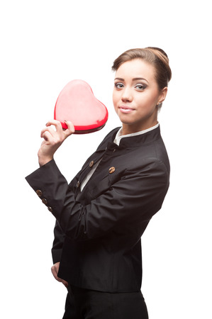 young happy business woman holding red Valentine heart isolated on white photo