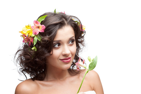 caucasian young smiling woman holding  pink lily flower isolated on white photo