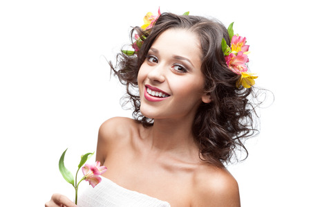 caucasian young smiling woman holding  pink lily flower isolated on white