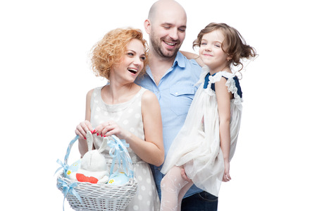 caucasian happy casual family with easter basket isolated on white