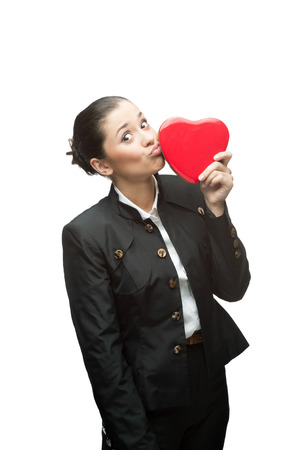 young caucasian business woman in black suit holding red heart isolated on white photo