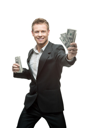 cheerful caucasian young businessman in gray suit holding money isolated on white background Stock Photo